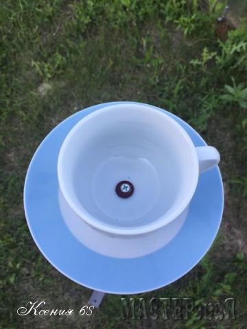 Кормушка для птиц из чайной пары и балясины