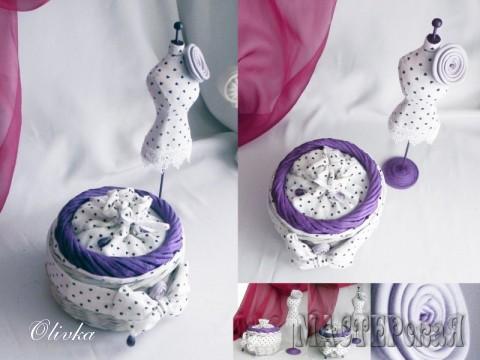 Шкатулочка - плетение из бумажной лозы.  Отделка: ткань - хлопок,  камень - аметист, кожа мебельная. Размер шкатулки: высота-12см; диаметр-14см.